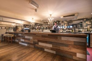The Swan Stafford Long bar with barman